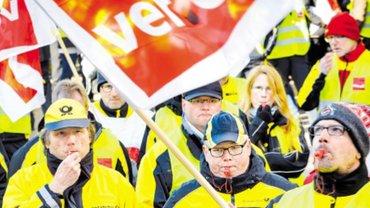 Titelblatt bewegen mit Demonstrierenden in gelben Warnwesten mit ver.di-Fahnen